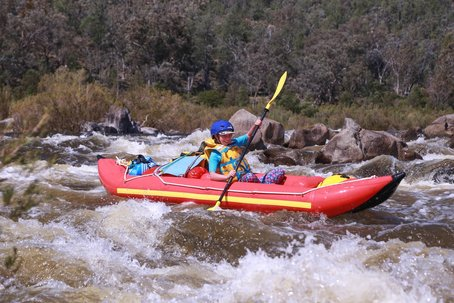 Rafting a rapid on the Snowy River, Australia's toughest wilderness river.