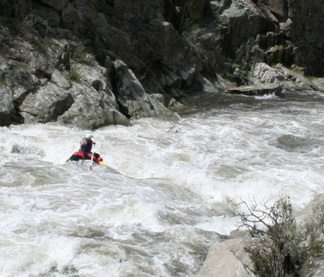Alpine River Adventures proprietor Richard Swain guiding a 6 person raft down the Snowy River, with 4000 megs released from Snowy Hydro